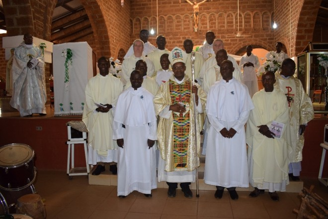 Brs. Leonard, Augustine with Bishop Richard and the priests after the profession